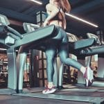 A women running on a treadmill in the gym after taking some caffeine pills